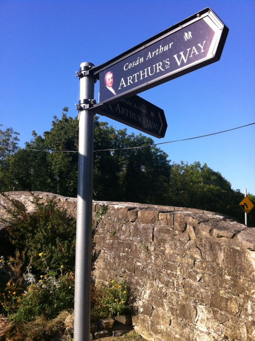 Bridge at Ardclough, and signs for Arthur's Way heritage walk.